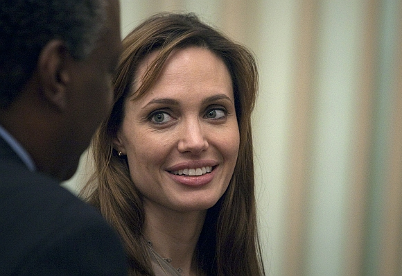 Angelina Jolie waits to meet Pakistan's Prime Minister Yusuf Raza Gilani at the prime minister's residence in Islamabad