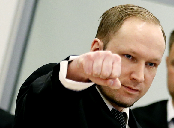 Defendant Anders Behring Breivik gestures as he arrives at the start of the third day of proceedings in courthouse in Oslo