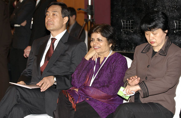 Bo Xilai, then China's commerce minister, with Asia Society President Vishaka Desai, center, and a Chinese lady, possibly Gu Kailai, Bo's wife, in Mumbai, March 2006