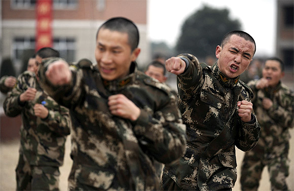Recruits from the People's Liberation Army attend a training session at a military base in Jiaxing, Zhejiang province