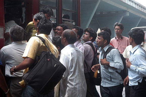Commuters jostle at the Kurla bus stand