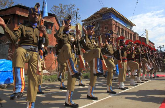 Police and CRPF personnel present the guard of honour at the bunker dismantling site at Lal Chowk