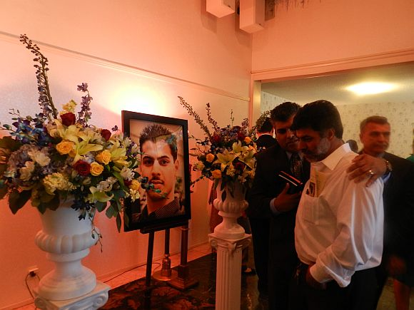 Rahul's father Prannath (in white shirt) at the funeral service