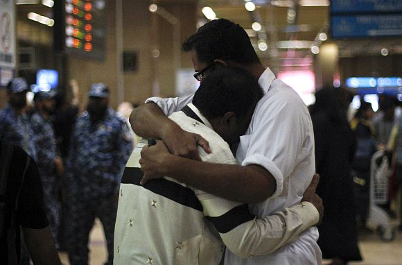Family members of the passengers of the Bhoja Air airliner crash console one another at Jinnah International airport in Karachi