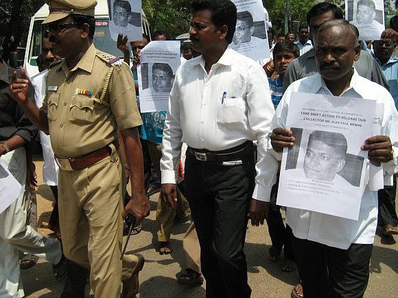 Residents of Tirunelveli gather at the collectorate office with posters of Alex Paul Thomas urging for his early release from Maoist captivation in Chhattisgarh