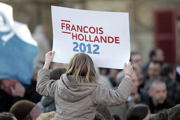 A supporter for Francois Hollande attends a campaign rally in Charleville-Mezieres