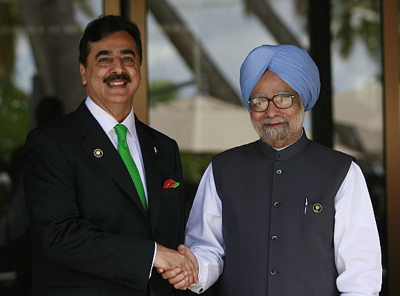 File image of Pakistan PM Gilani shaking hands with PM Singh during the 17th SAARC summit in Maldives