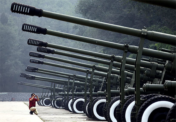 A row of old anti-aircraft guns on display outside Beijing