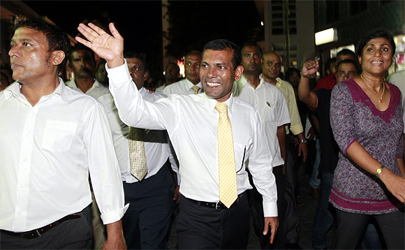 Former Maldives President Mohamed Nasheed waves at his supporters