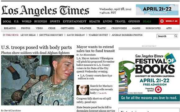 Los Angeles Times published pictures showing soldier from the Army's 82nd Airborne division with the body of a killed Afghan insurgent