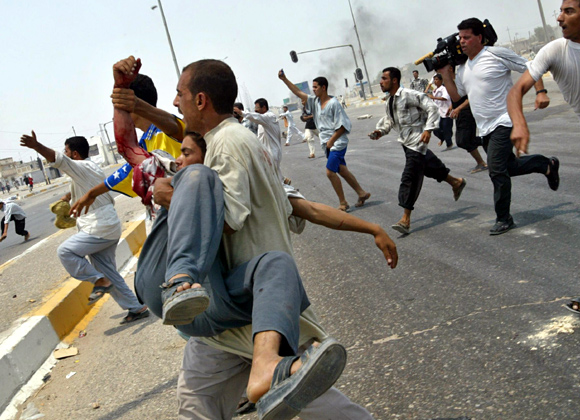 SHOCKING PIX! Journalists in the line of fire