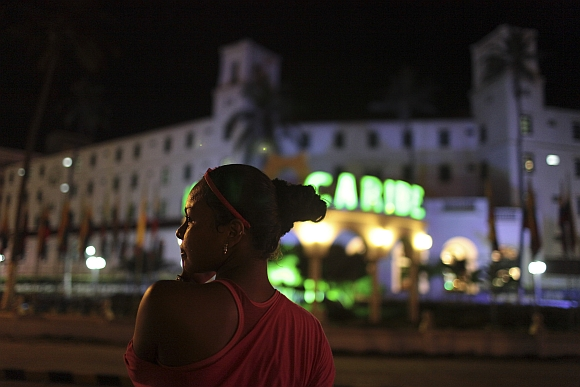 A prostitute stands in front of the Hotel Caribe in Cartagena