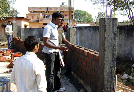 Collector Alex Paul Menon at a lowcost Bharat Nirman project site in Chhattisgarh