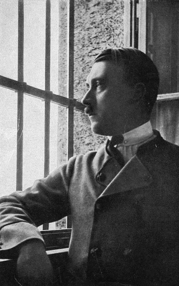 Adolf Hitler looks out of a barred window in Landsberg jail where he dictated his autobiography, Mein Kampf