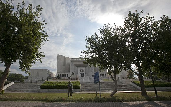 A security official stands guard outside the supreme court in Islamabad on Thursday