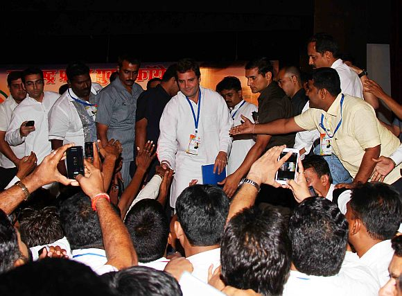 Rahul Gandhi shakes hands with young Congress workers during a function in Mumbai on Friday