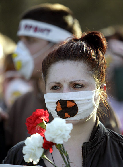Activists wearing masks with a radioactive danger sign attend an opposition protest to mark the Chernobyl nuclear accident in Minsk