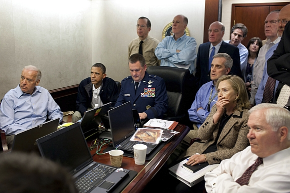 US President Barack Obama (2nd L) and Vice President Joe Biden (L), along with members of the national security team, receive an update on the mission against Osama bin Laden in the Situation Room of the White House