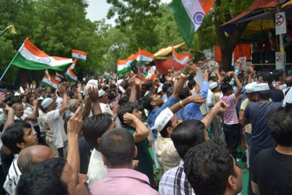 Supporters of Anna Hazare shout slogans at Jantar Mantar in New Delhi