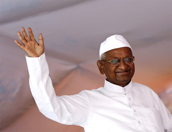 Social activist Anna Hazare waves to his supporters during his public hunger strike in New Delhi