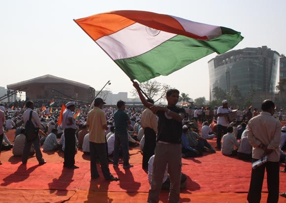 A supporter of Anna Hazare waves the tricolour during his anti-graft fast at BKC Grounds in Mumbai last year