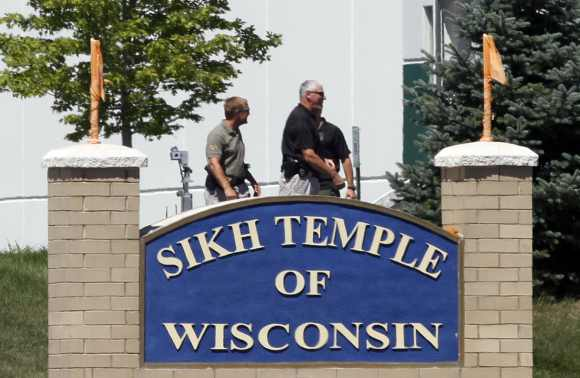 Officials gather near the Sikh Temple in Oak Creek in Wisconsin August 5 following a mass shooting inside and outside the gurudwara