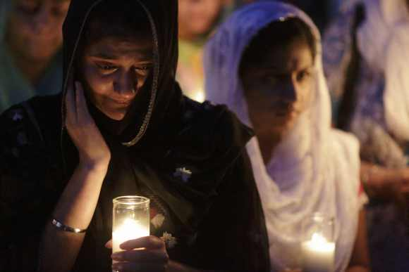 Mourners cry during a candlelight vigil at the Sikh Temple in Brookfield, Wisconsin August 6