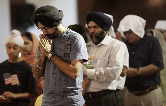 Mourners attend a prayer service at the Sikh Temple in Brookfield, Wisconsin