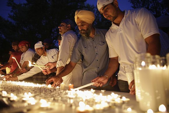 Mourners prepare for a candlelight vigil at the Sikh Temple in Brookfield, Wisconsin