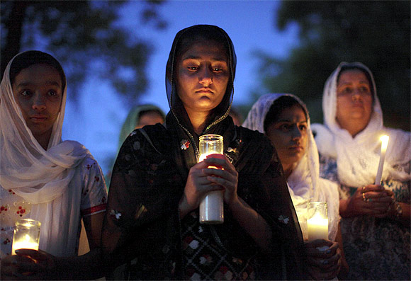 Mourners attend a candlelight vigil at the Sikh temple in Brookfield, Wisconsin