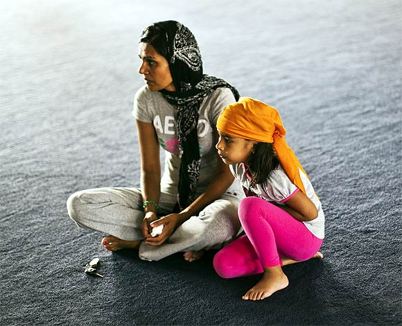 Raj Kaur (Left) and her four-year-old daughter Sahaj Kaur pray at the Gurdwara Sahib Sikh Temple in West Sacramento, California