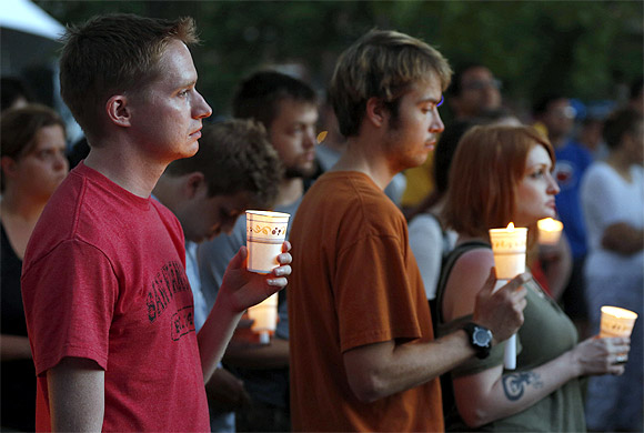 People gather at a candle light vigil at Cathedral Square in downtown Milwaukee, Wisconsin