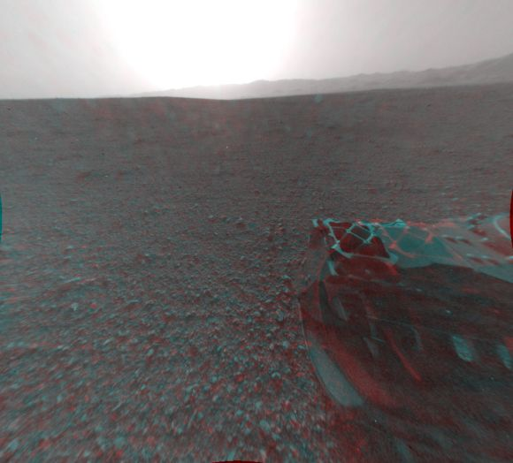 This cropped image is a 3-D view behind NASA's Curiosity rover. The anaglyph was made from a stereo pair of Hazard-Avoidance Cameras on the rear of the rover.