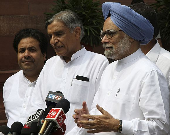 Dr Singh with Parliamentary Affairs Minister Pawan Kumar Bansal and MoS PMO Rajiv Shukla