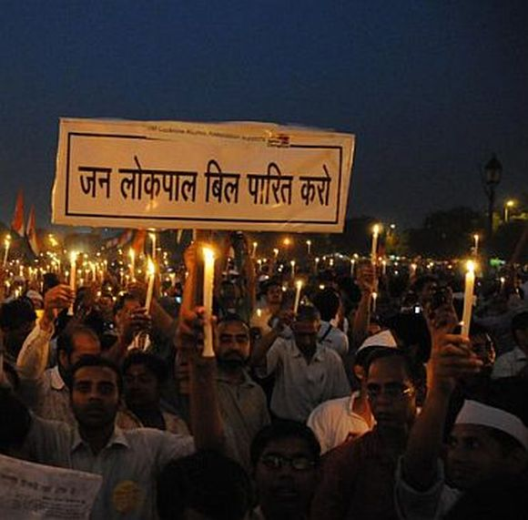 Supporters of Anna Hazare demonstrate for a stronger Lokpal Bill in New Delhi