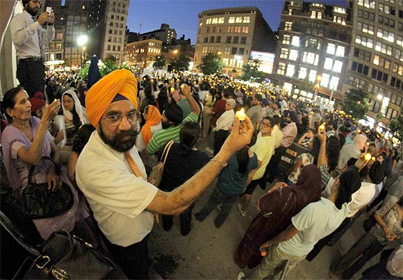 Sikh Americans hold a candlelight vigil to protest the gurdwara shootout in New York city