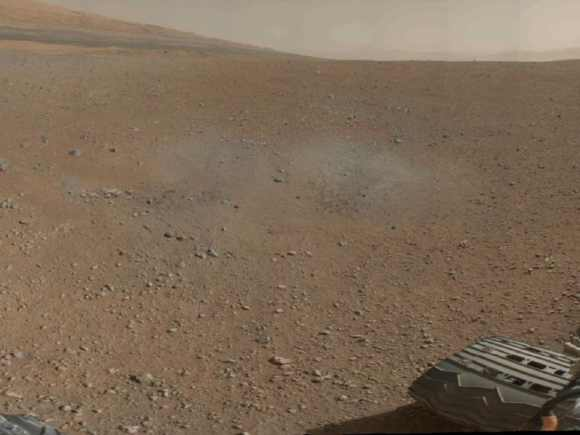 This is a portion of the first colour 360-degree panorama from NASA's Curiosity rover, made up of thumbnails, which are small copies of higher-resolution images. The mission's destination, a mountain at the center of Gale Crater called Mount Sharp, can be seen in the distance, to the left