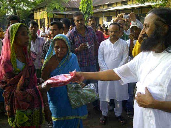 Sri Sri Ravi Shankar at the Basugaon Higher Secondary School relief camp in Assam