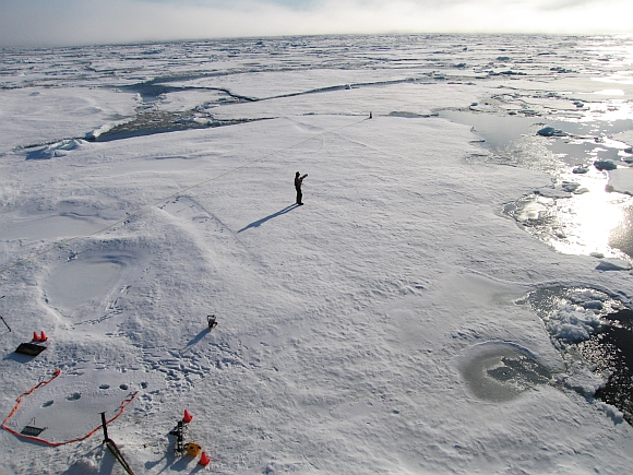 A member of a team of Cambridge scientists trying to find out why Arctic sea ice is melting so fast, walks on some drift ice 800 km from the North Pole