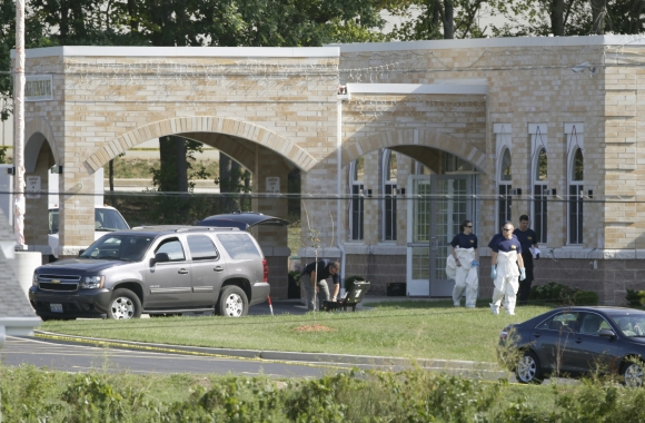 FBI agents walk past the entrance to the Sikh Temple in Oak Creek, Wisconsin