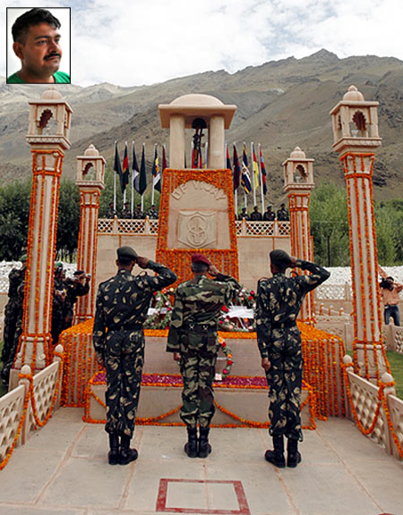 Indian army personnel salute the Kargil war memorial in Drass, Jammu and Kashmir. Inset: Param Vir Chakra winner Yogendra Yadav