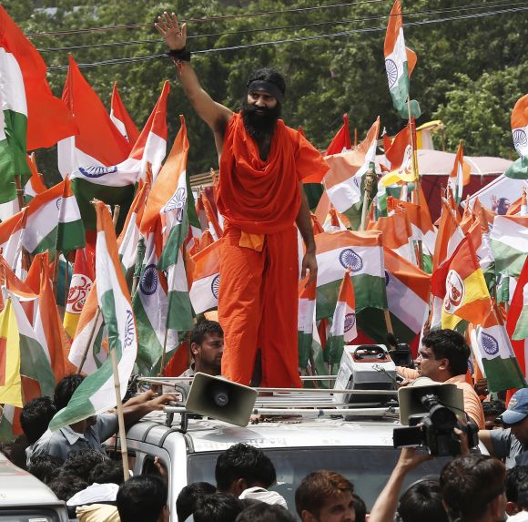 Ramdev waves to his supporters during a protest march against corruption in New Delhi