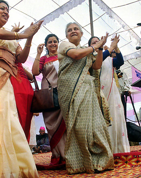 Delhi Chief Minister Sheila Dikshit with a group of dancers.