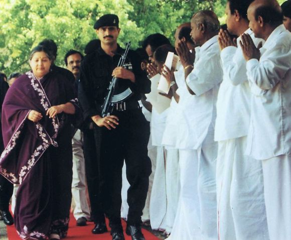 Tamil Nadu Chief Minister JJayalalithaa, flanked by a securityman