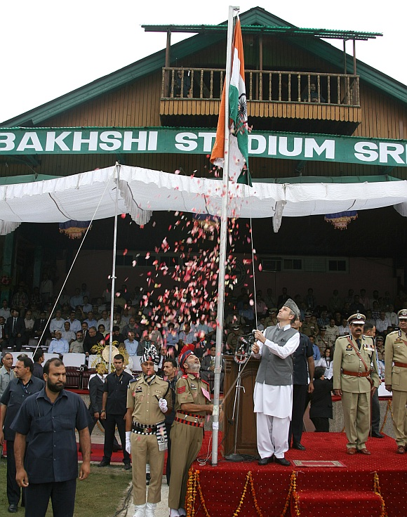 jammu and Kashmir Chief Minister Omar Abdullah unfurls the Tricolour during Independence Day celebrations functions