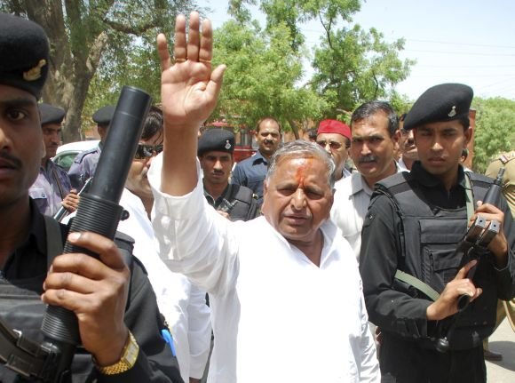 Samajwadi Party Chief Mulayam Singh Yadav waves to his supporters after filing his nomination at Mainpuri in Uttar Pradesh