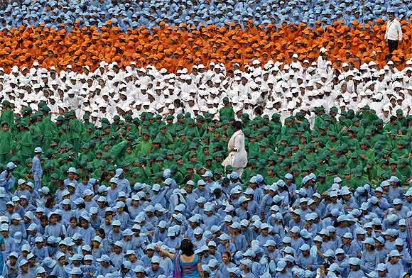 Schoolchildren take part in the Independence Day celebrations in front of the historic Red For