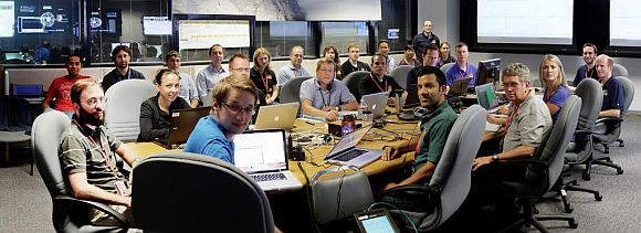This image shows Curiosity's Entry, Descent and Landing (EDL) war room and its staff.