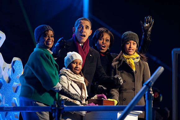 President Barack Obama, with mother-in-law Marian Robinson, daughters Sasha and Malia, and First Lady Michelle Obama