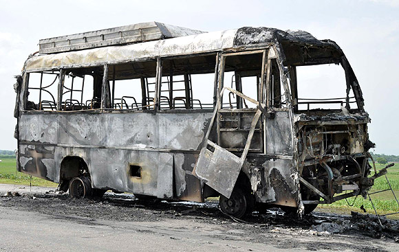 A mob torches a bus in violence-hit Assam